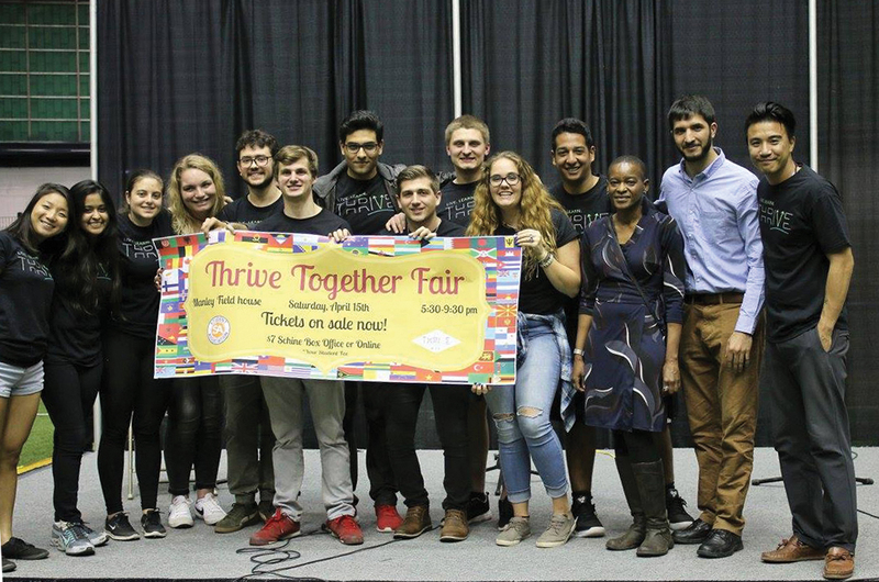 Photo of students holding a banner at last year's Thrive Cultural Fair