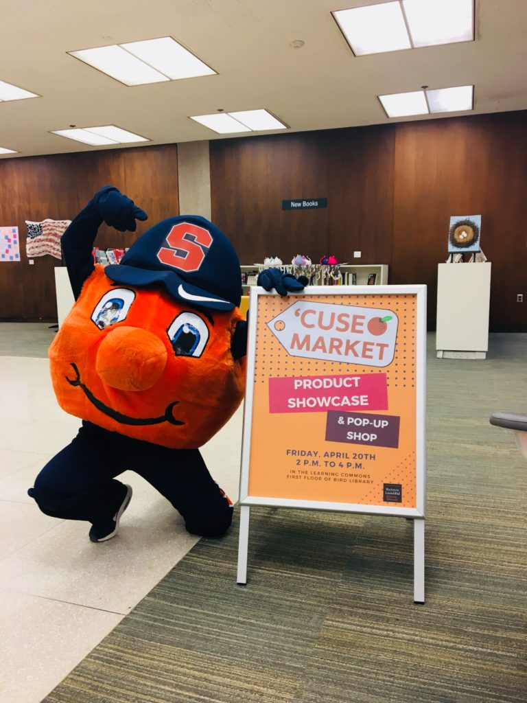 Otto with 'Cuse Market sign