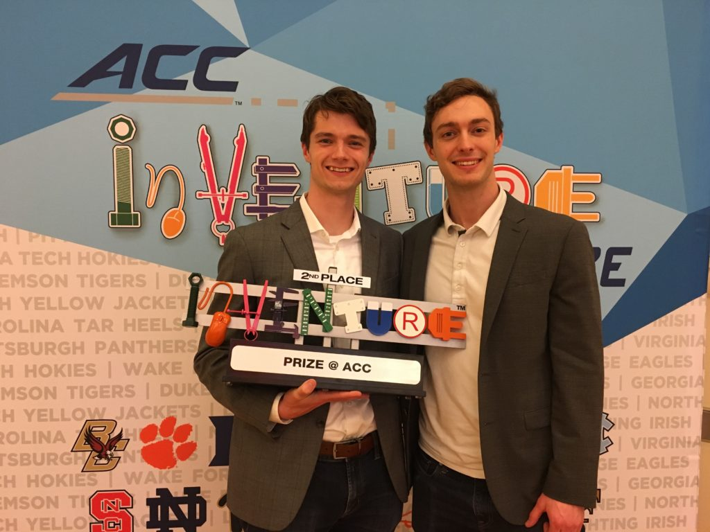 Quinn King and Alec Gillinder with ACC award