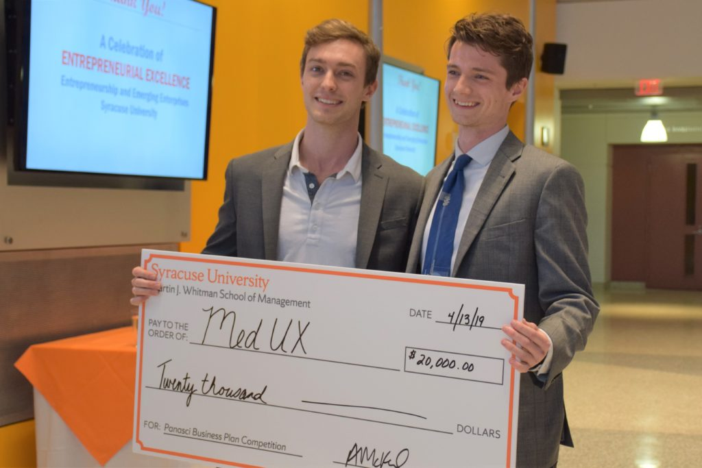 Alec and Quinn with prize check