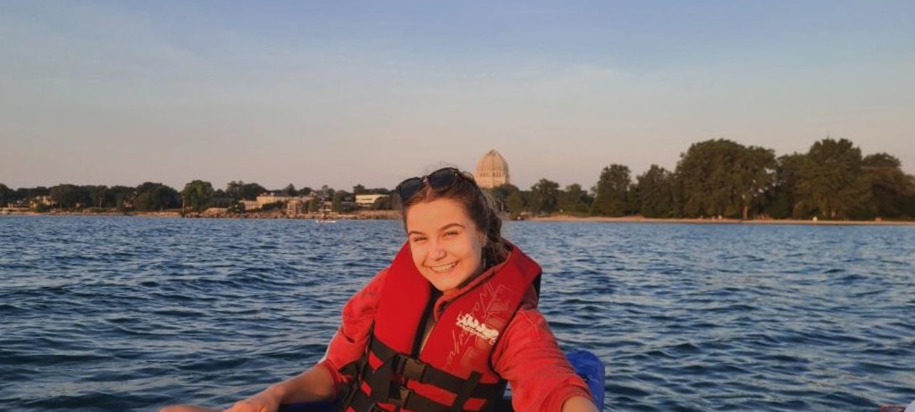 student in a life vest on a canal in Venice