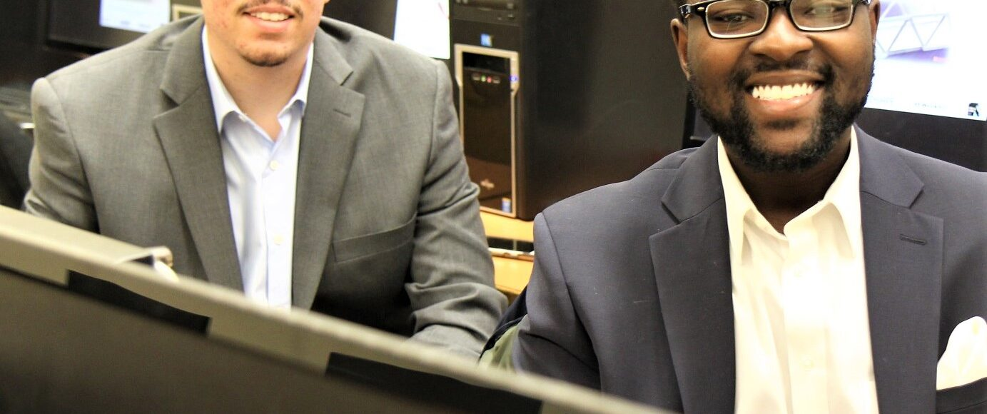 two founders sitting a computers