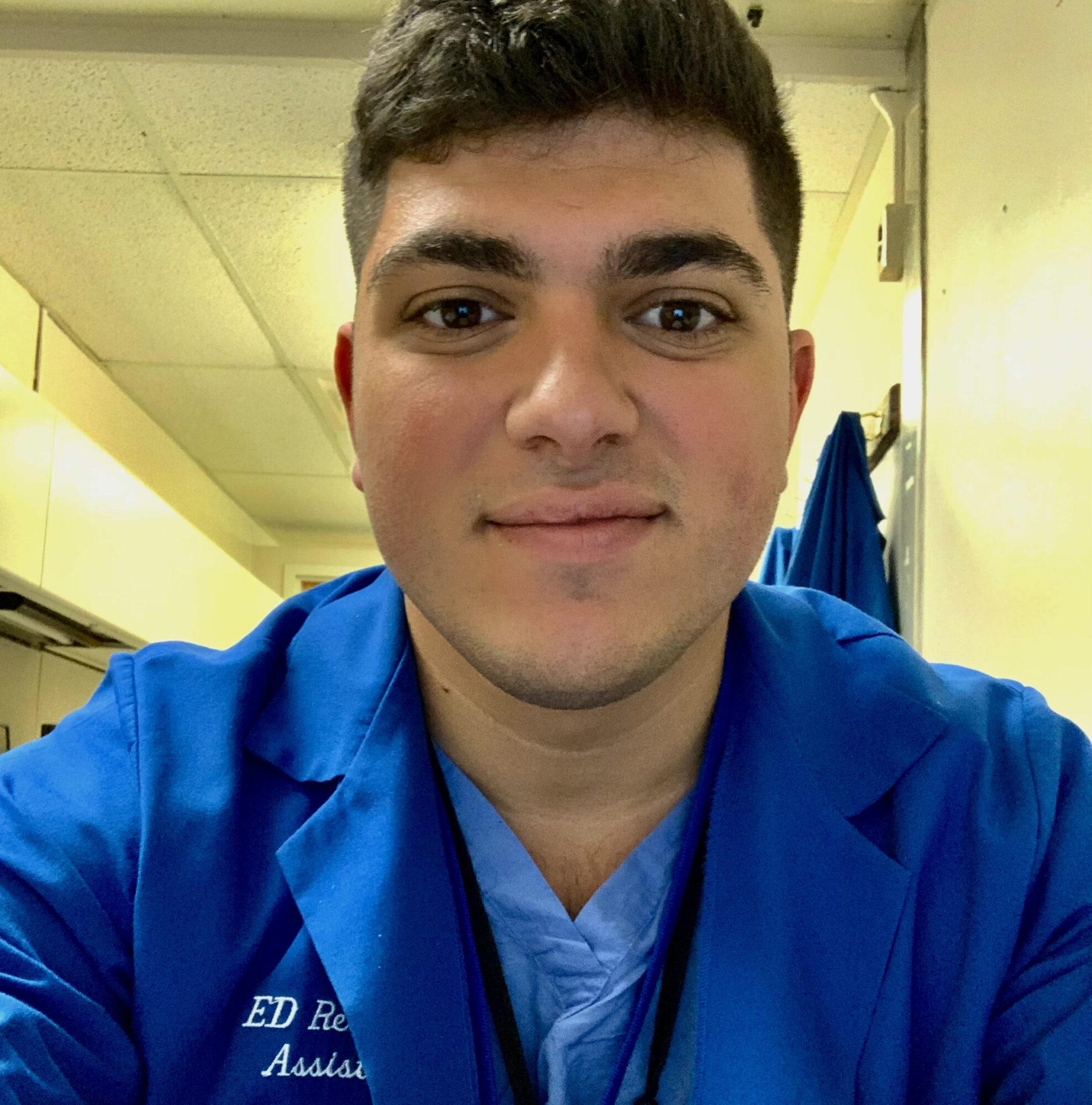 headshot of a man in a dental jacket