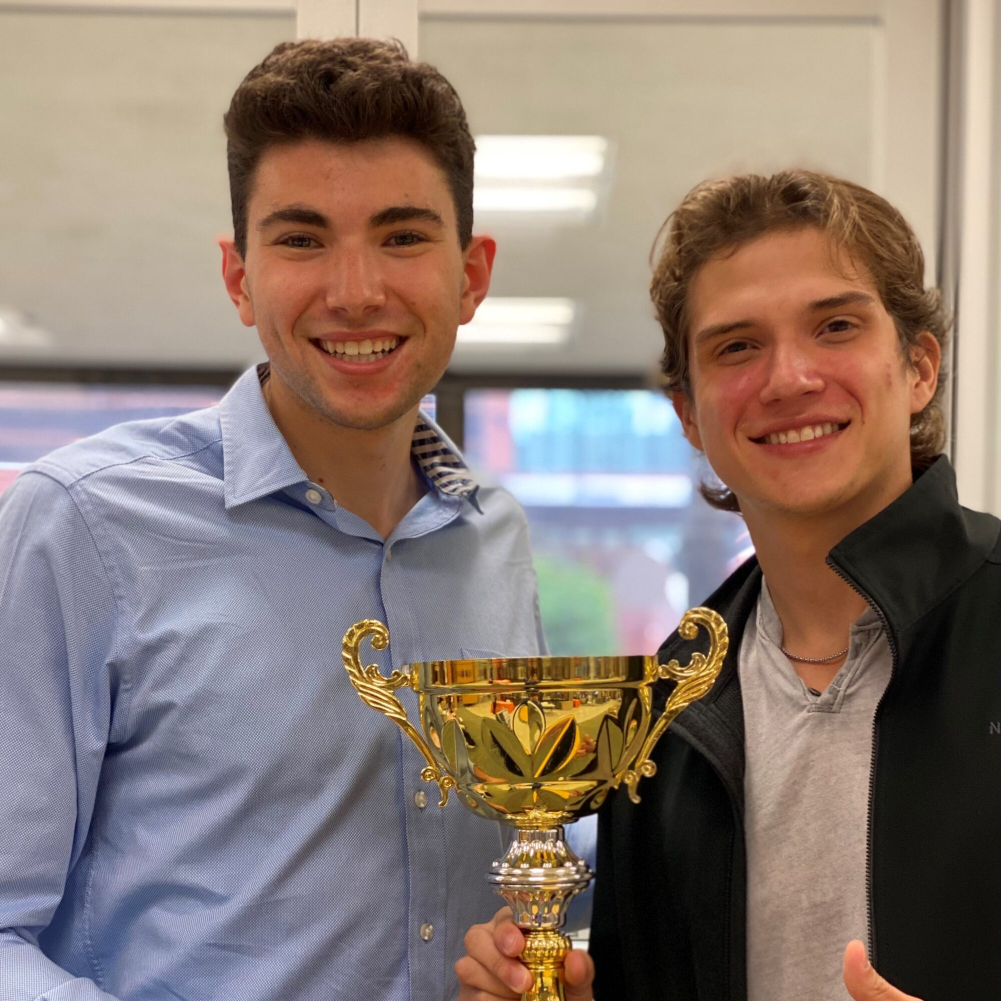 two students with a trophy
